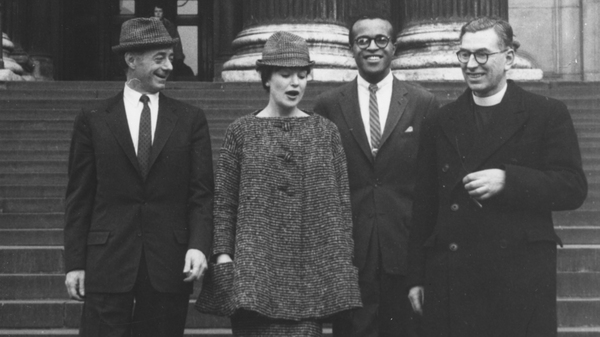 Jazz singers, Dave Lambert (left), Annie Ross and Jon Hendricks with Canon L. John Collins on the steps of St Paul