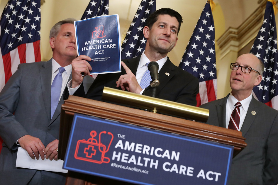 Speaker of the House Paul Ryan holds up a copy of the American Health Care Act during a March 7 news conference with House Majority Leader Kevin McCarthy, R-Calif. (left), and House Energy and Commerce Committee Chairman Greg Walden, R-Ore., outside Ryan's office in the Capitol. (Chip Somodevilla/Getty Images)
