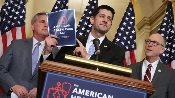 Speaker of the House Paul Ryan holds up a copy of the American Health Care Act during a news conference with House Majority Leader Kevin McCarthy R-Calif., (left) and House Energy and Commerce Committee Chairman Greg Walden (R-Ore.) outside Ryan