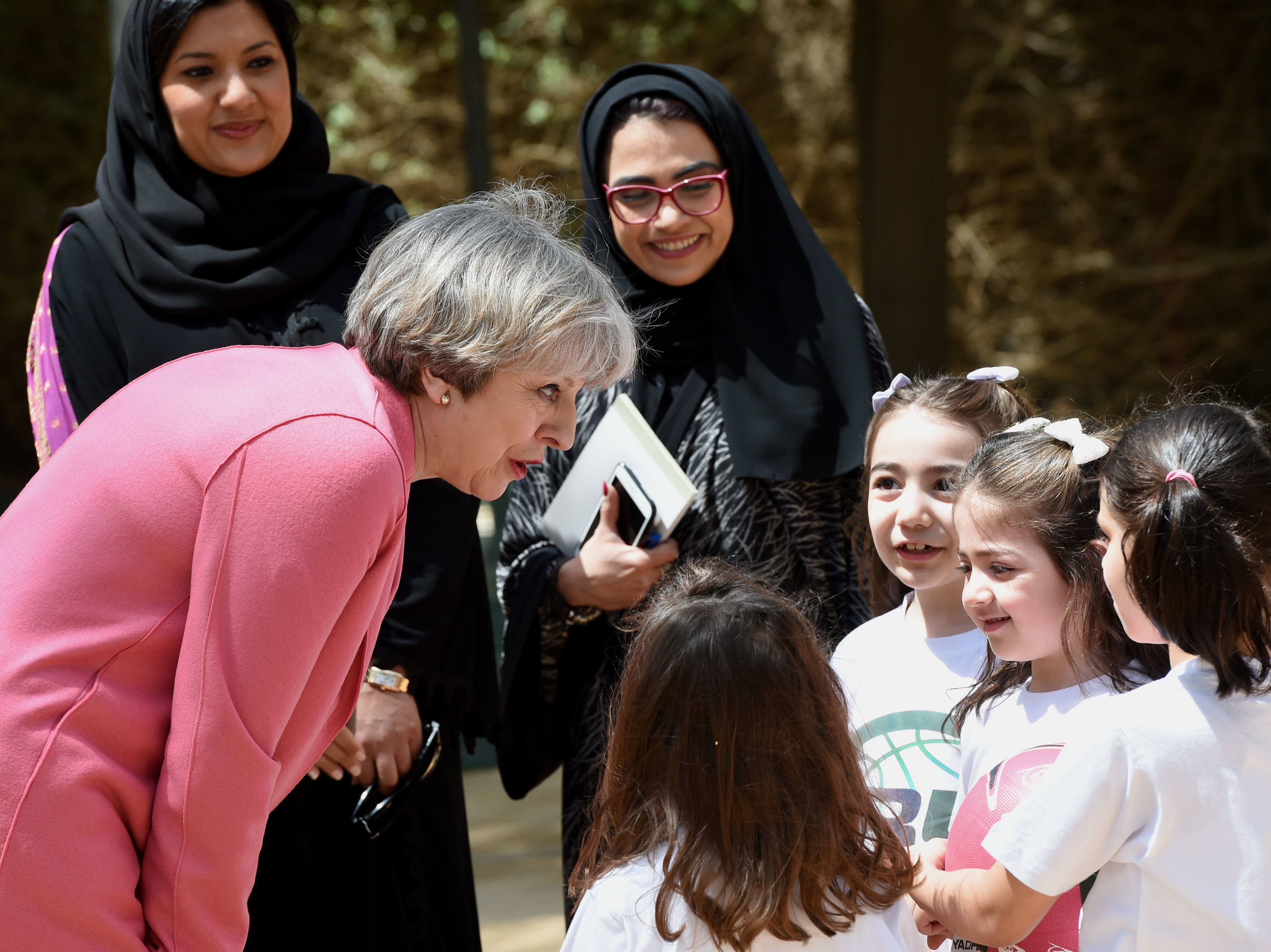 British Prime Minister Theresa May chats with Saudi girls during a basketball class while on a visit to Riyadh last month.     (Fayez Nureldine/AFP/Getty Images)