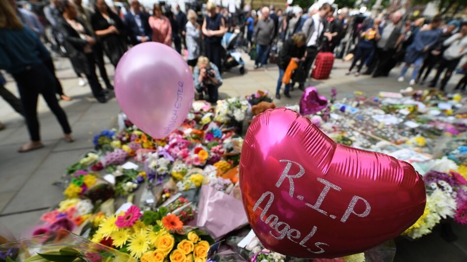 Balloons and flowers filled a memorial in Albert Square in central Manchester, in northwest England, in tribute to the victims of the Monday night attack at the Manchester Arena. (Chris J. Ratcliffe/AFP/Getty Images)