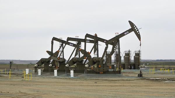 A rig digs deep underground into oil-rich shale in North Dakota