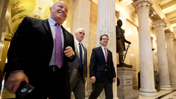 Rep. Kevin Brady, R-Texas, left, walks with Vice President Mike Pence and and Rep. Peter Roskam, R-Ill., on Capitol Hill on Monday.