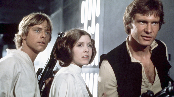 Actors Mark Hamill, Carrie Fisher and Harrison Ford on the set of the original Star Wars film. The movie was originally released on May 25, 1977.