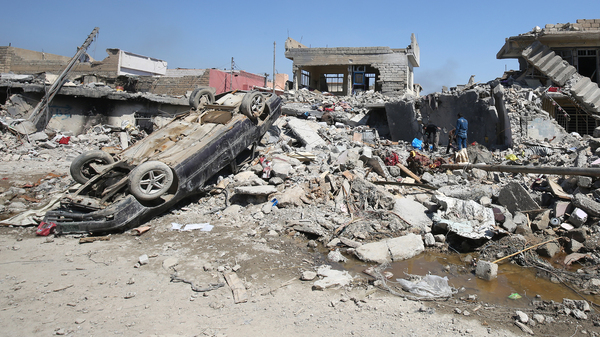 Iraqis inspect the damage in Mosul