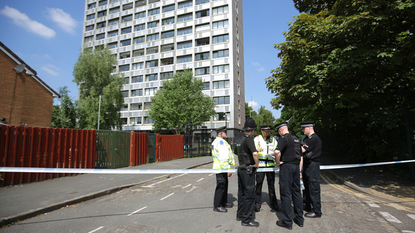 Police seal off Lindy Road in Manchester, England, as the investigation into Monday night