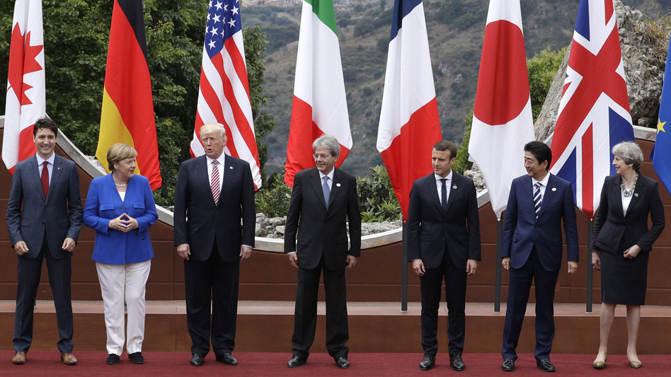 (From left) Canadian Prime Minister Justin Trudeau, German Chancellor Angela Merkel, U.S. President Trump, Italian Prime Minister Paolo Gentiloni, French President Emmanuel Macron, Japan's Prime Minister Shinzo Abe and British Prime Minister Theresa May pose during the G-7 summit in Taormina, Italy, on Friday. (Andrew Medichini/AP)