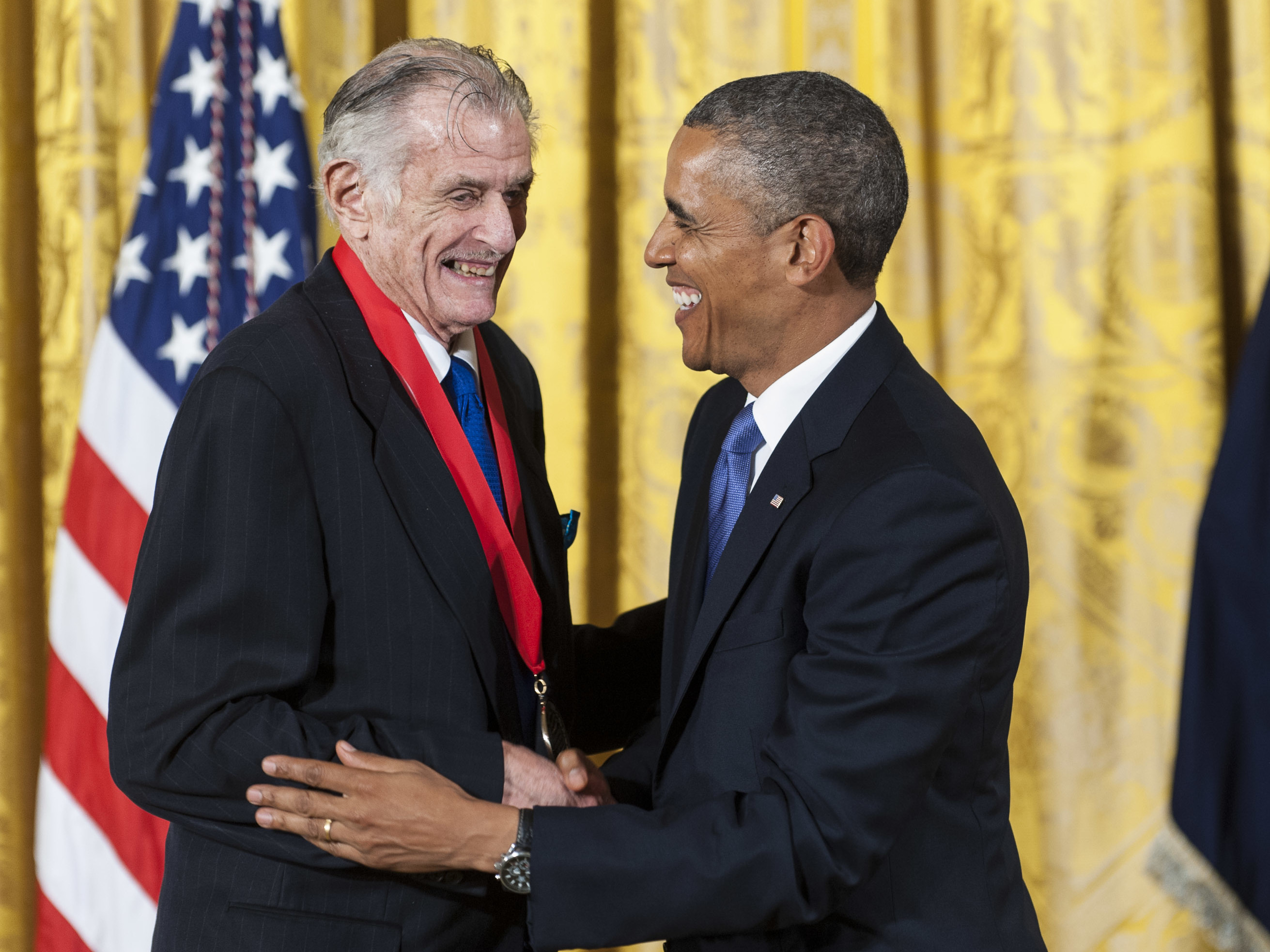 President Obama presents the National Humanities Medal to Frank Deford at the White House in 2013. (Pete Marovich/Getty Images)