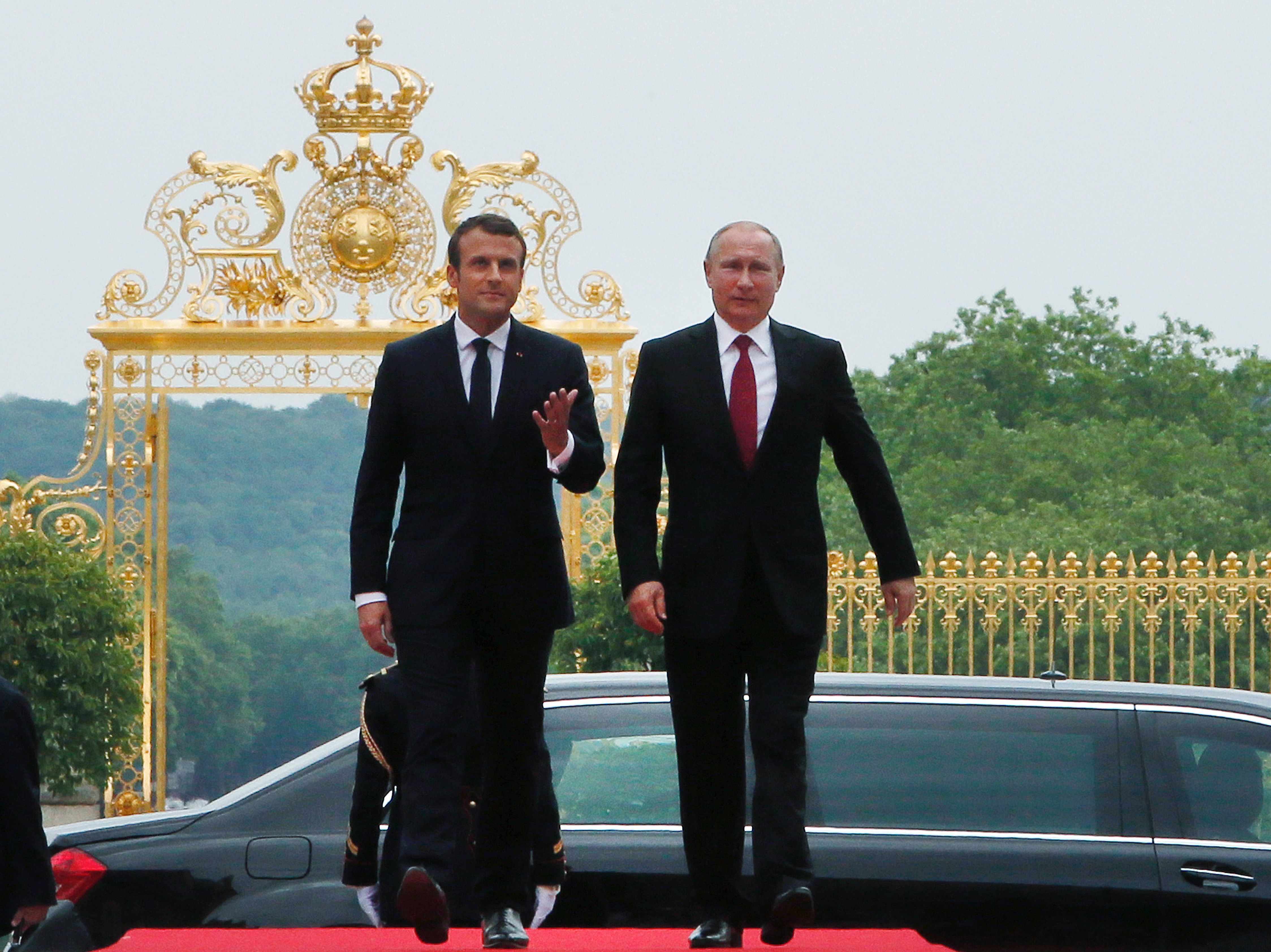 Macron explains his tense handshake with Trump