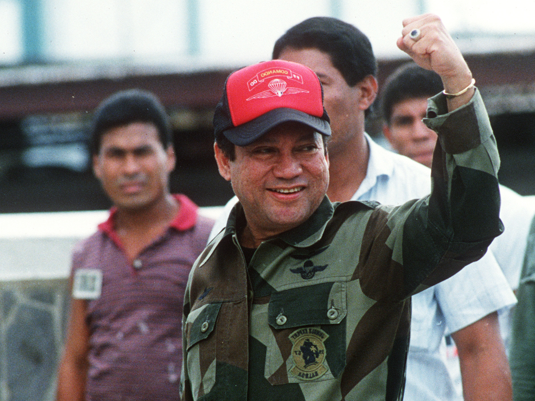 In this 1989 photograph, former Panamanian leader Gen. Manuel Noriega waves while leaving his headquarters in Panama City following a failed coup against him. It was just months before Noriega would surrender power amid a U.S. military operation against his government. (Bob Sullivan/AFP/Getty Images)