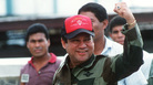 In this 1989 photograph, former Panamanian leader Gen. Manuel Noriega waves while leaving his headquarters in Panama City following a failed coup against him. It was just months before Noriega would surrender power amid a U.S. military operation against his government.
