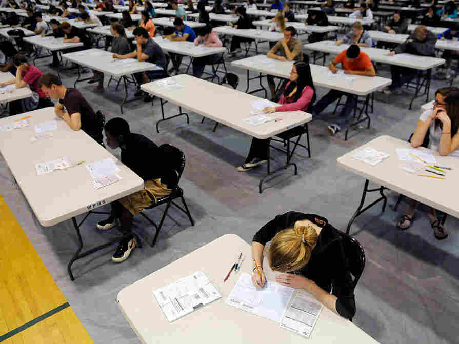 Lindsey Boggess, 17, bottom right, waits with other students to take an AP exam at West Potomac High School on Tuesday May 10, 2011 in Alexandria, VA.