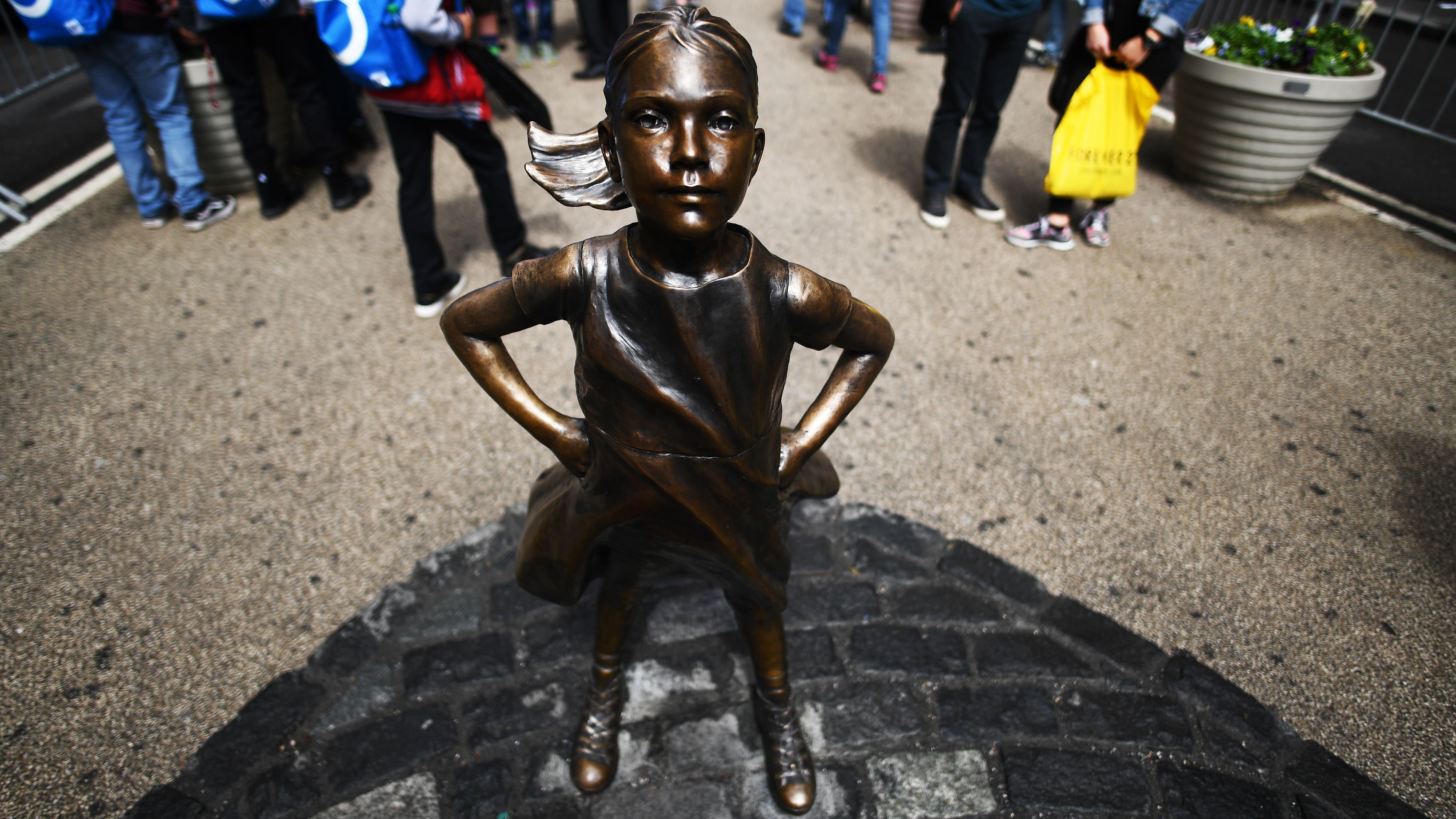 Urinating dog statue briefly placed near 'Fearless Girl' art