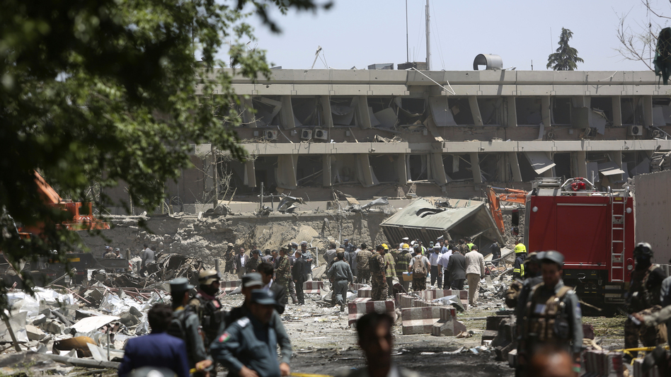 Security forces inspect the site of a massive explosion in a busy area not far from the German Embassy in Kabul, Afghanistan, on Wednesday. (Rahmat Gul/AP)