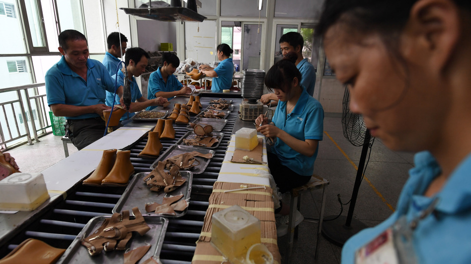 Workers assemble shoes in 2016 at a Huajian shoe factory in southern China, where about 100,000 pairs of Ivanka Trump-branded shoes have been made over the years. (Greg Baker/AFP/Getty Images)