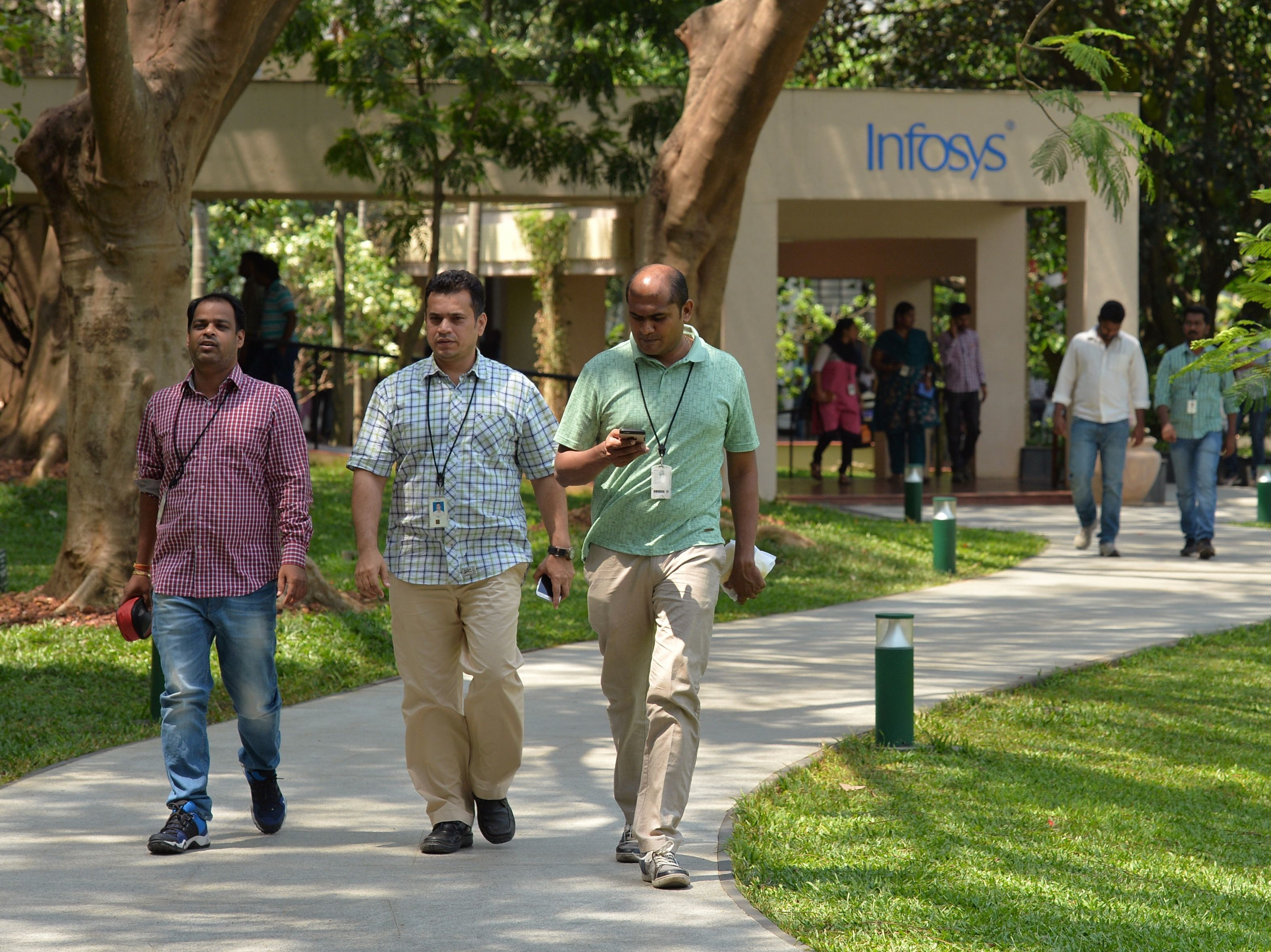 Employees of Infosys Technologies walk on the campus of the company's headquarters in Bangalore, India, on April 13. (Manjunath Kiran/AFP/Getty Images)