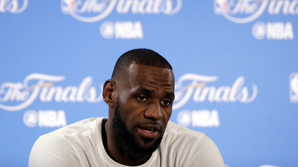 "After racist graffiti was sprayed on the gate of his house in Los Angeles, the Cleveland Cavaliers' LeBron James spoke about racism, saying ""Hate in America, especially for African-Americans, is living every day."" (Marcio Jose Sanchez/AP)"