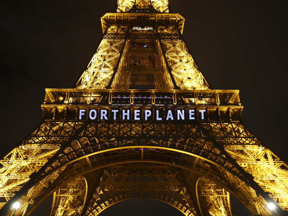 "The slogan ""For The Planet"" is projected on the Eiffel Tower as part of the United Nations Climate Change Conference in Paris in December 2015. (Francois Mori/AP)"