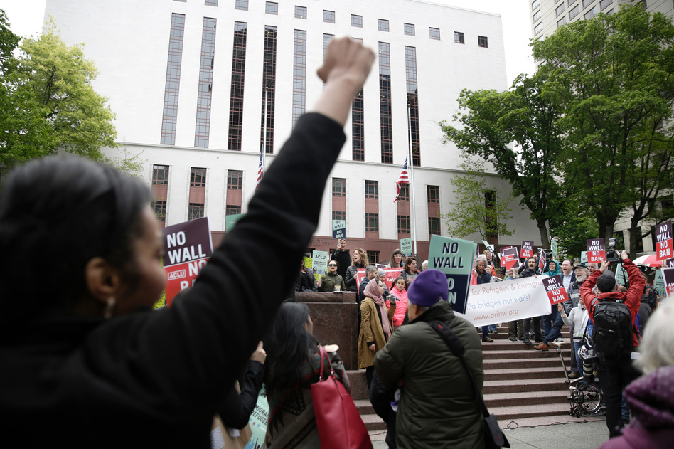 Protesters gather outside the 9th U.S. Circuit Court of Appeals in Seattle last month as judges prepare to hear arguments on the revised travel ban. This week, the Justice Department took its challenge to blocks on the ban to the U.S. Supreme Court. (Jason Redmond/AFP/Getty Images)