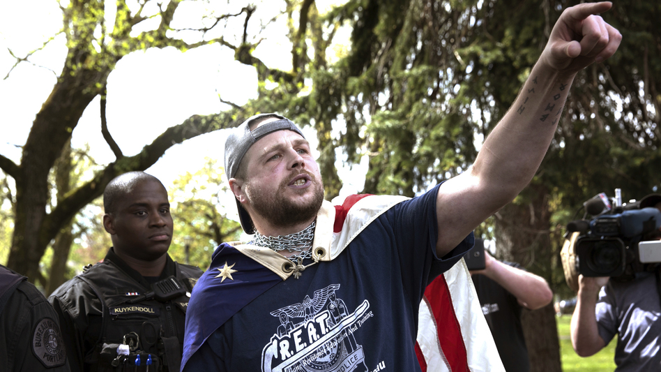 "Jeremy Christian (right), seen during a Patriot Prayer, allegedly stabbed three men, two fatally, in Portland earlier this year. During a subsequent courtroom appearance, he exclaimed: ""Free speech or die, Portland. You call it terrorism I call it patriotism."" (John Rudoff/AP)"
