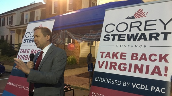 "Corey Stewart, seen at a campaign rally in Virginia Beach, Va., is appealing to supporters of President Trump on the campaign trail. ""Who"