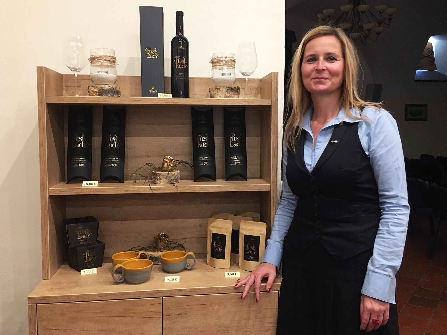 Mojca Pernovsek, head of Sevnica's tourism bureau, at the town's 900-year-old castle, where First Lady products are sold honoring native daughter Melania Trump. They include specially made wine, salami, chocolate, teacups and face cream.     (Joanna Kakissis for NPR)
