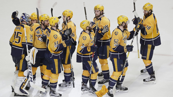 The Nashville Predators celebrate after their 4-1 win over the Pittsburgh Penguins in Game 4 of the NHL Stanley Cup Final on Monday night in Nashville, Tenn.