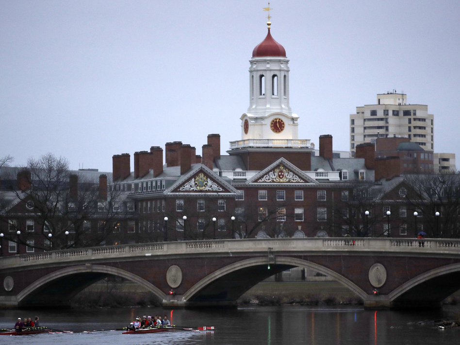 At least 10 admitted Harvard students had their admissions offers rescinded after a group exchange of racist and sexually offensive Facebook messages. (Charles Krupa/AP)