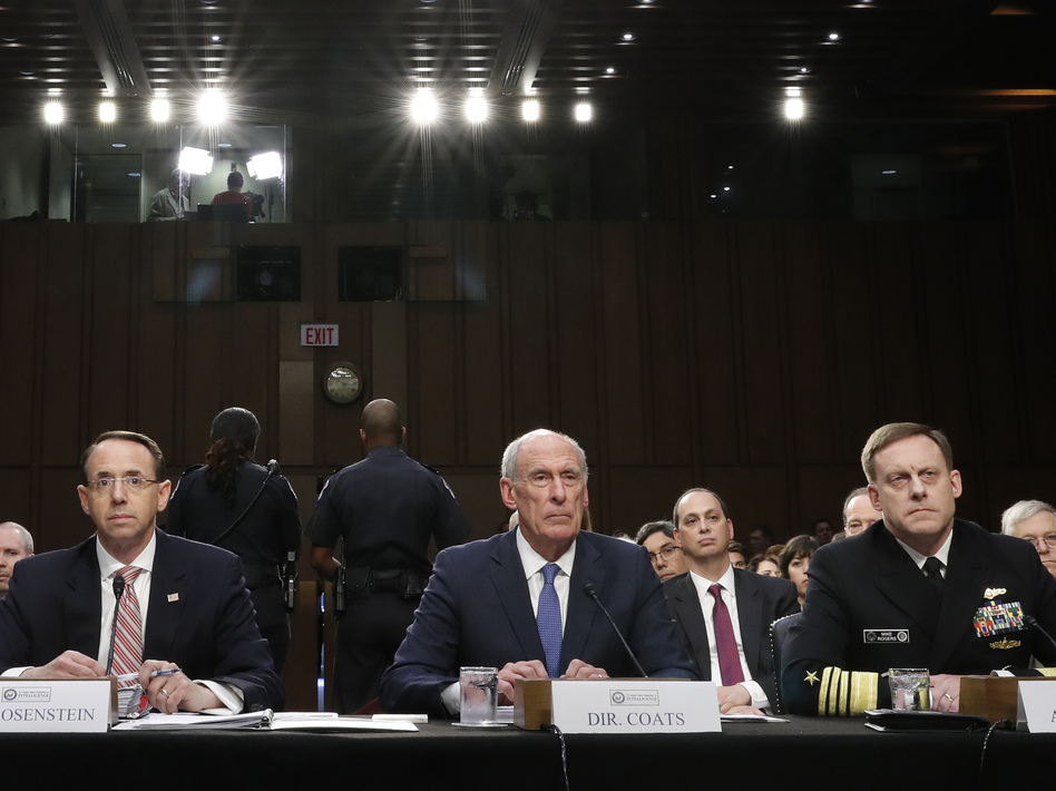 Acting FBI Director Andrew McCabe (left), Deputy Attorney General Rod Rosenstein, National Intelligence Director Dan Coats, and National Security Agency Director Adm. Michael Rogers are seated during a Senate Intelligence Committee hearing about the Foreign Intelligence Surveillance Act on Wednesday. (Alex Brandon/AP)