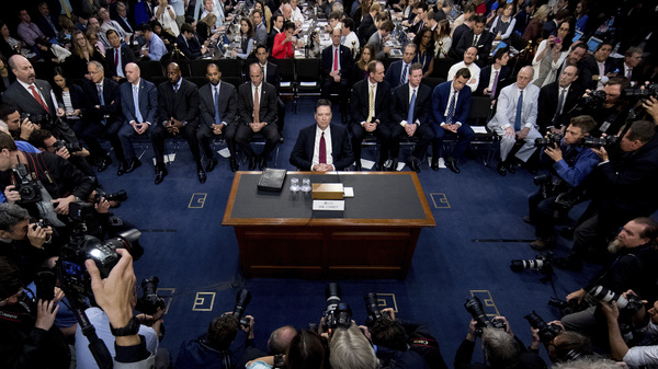 Former FBI Director James Comey takes his seat to testify at a Senate Intelligence Committee hearing on Capitol Hill on Thursday.