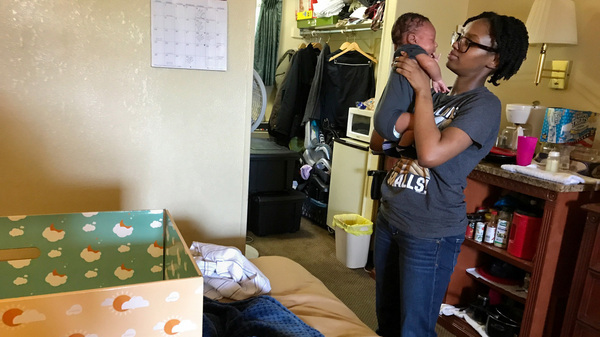 New Jersey has been distributing baby boxes — cardboard containers that double as cribs or bassinets — to new parents since January. Maisha Watson is currently living in a motel outside Atlantic City, N.J., with her infant son, Solomon Murphy. With no room for a crib, Solomon sleeps in the baby box.