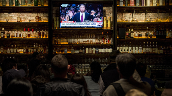 A crowd gathered for a watch party at The Partisan bar in Washington, D.C., on Thursday, as former FBI Director James Comey testified before the Senate Select Intelligence Committee.