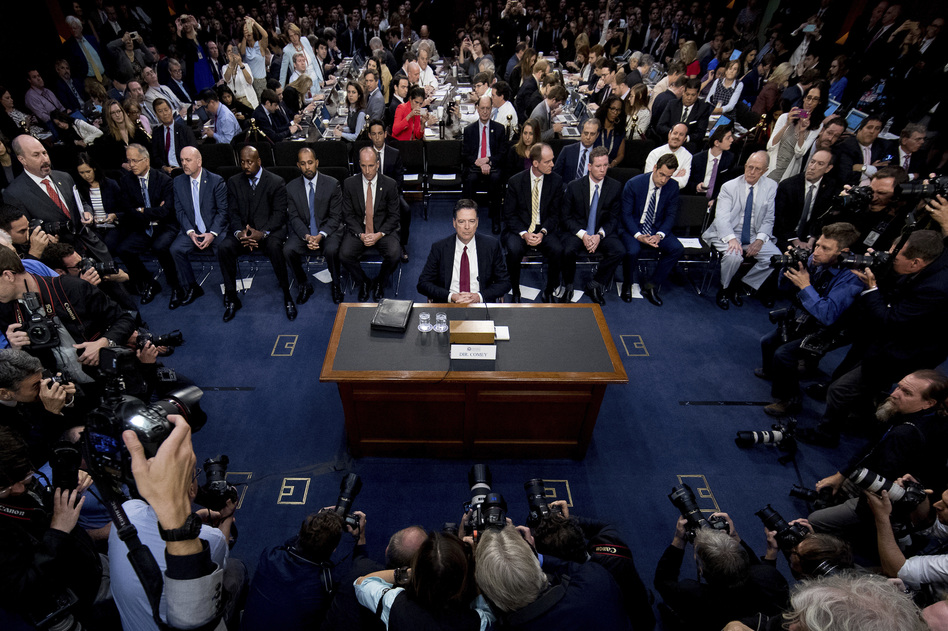 Former FBI Director James Comey takes his seat to testify at a Senate Intelligence Committee hearing on Capitol Hill on Thursday. (Andrew Harnik/AP)