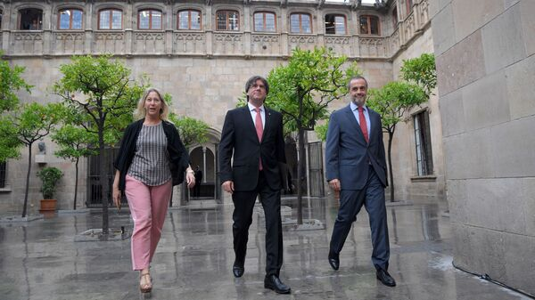 President of the Catalan regional government Carles Puigdemont (center) announced a referendum for independence from Spain on Friday in Barcelona.