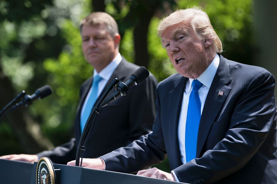 President Trump and Romania's President Klaus Iohannis at a press conference in the Rose Garden of the White House on Friday. (Brendan Smialowski/AFP/Getty Images)