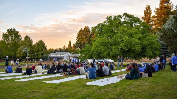 Open Iftar events are held outdoors (weather permitting), and are open to all. Often there are guest speakers and evening prayers, and then everyone —Muslim and non-Muslim alike —breaks bread together. Above, attendees at the first U.S. Open Iftar, held in Portland, Ore., in 2016.