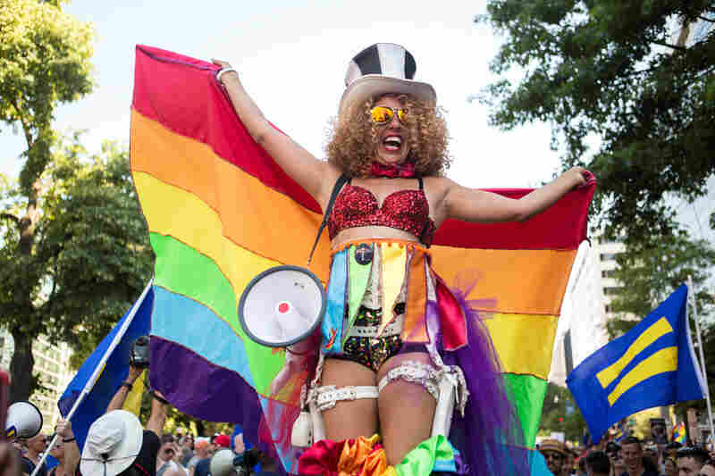 Regina Armenta of Philadelphia, Pa., cheered from above the crowd atop a pair of stilts during the Equality March in Washington, D.C., on Sunday, June 11.