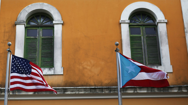 A U.S. flag flies beside a Puerto Rican flag in Old San Juan.