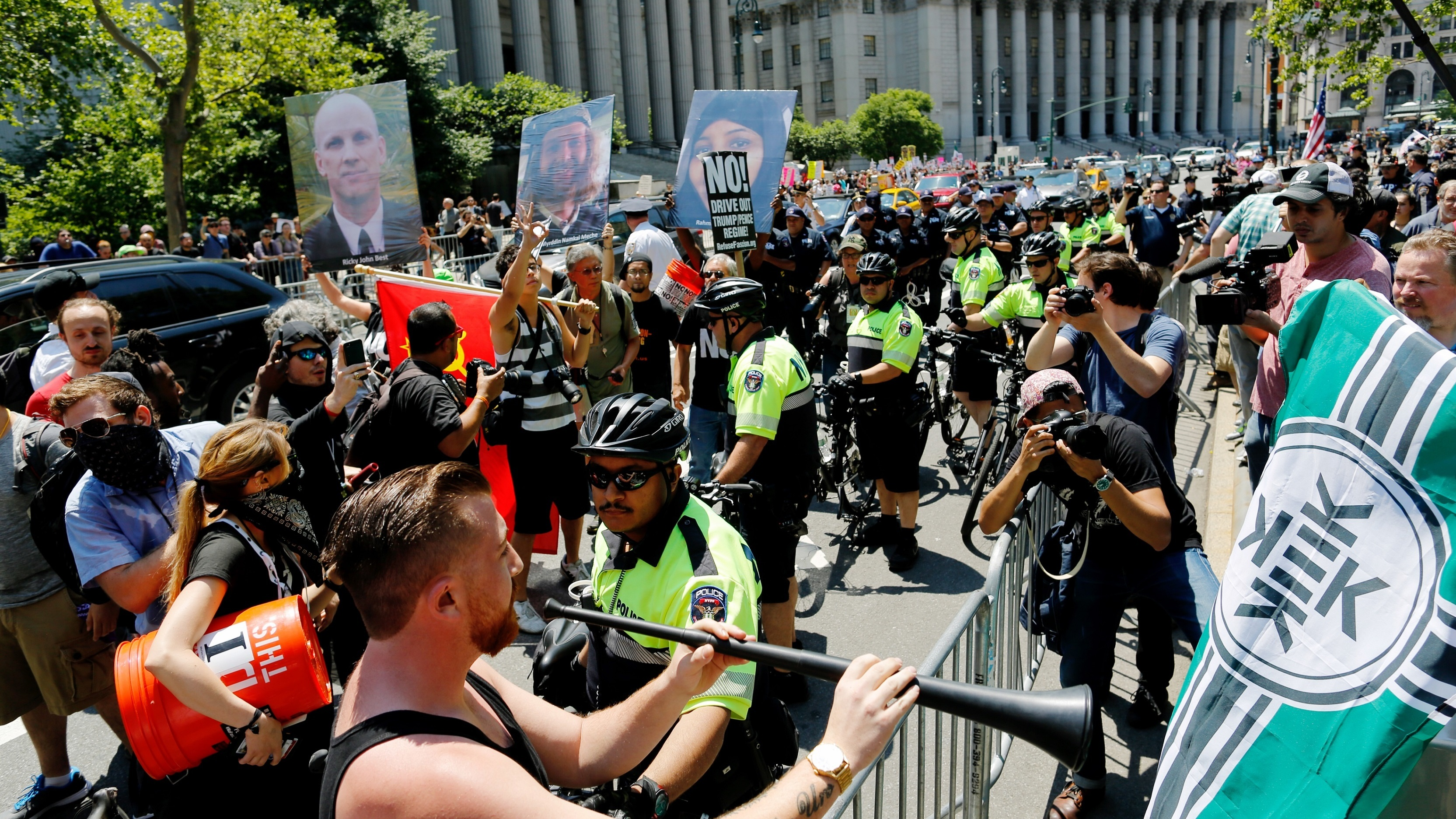 NYPD officers try to separate counter-protesters and activists rallying for the