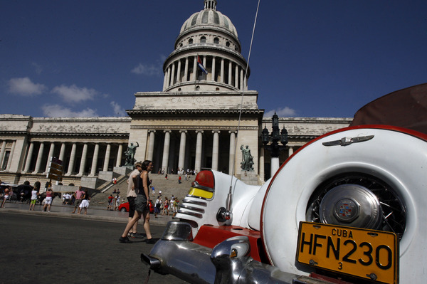 An American classic car is seen parked in front of the Capitol building in Havana. President Trump's expected changes in policy toward Cuba could make it more difficult for Americans to visit the island and for U.S. companies to do business there.