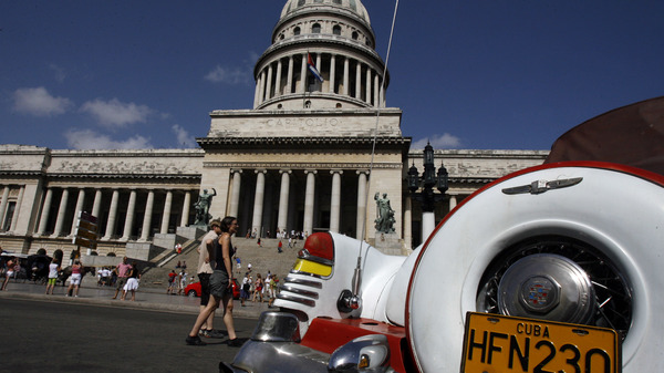 An American classic car is seen parked in front of the Capitol building in Havana.