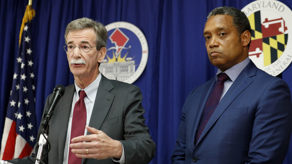 Maryland Attorney General Brian Frosh (left) and District of Columbia Attorney General Karl Racine announce a lawsuit against President Trump about conflicts of interest with his businesses on Monday in Washington.