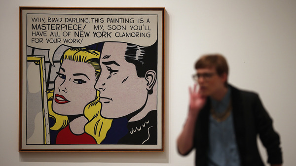 "A visitor stands in front of Masterpiece during a press preview of ""Lichtenstein, a Retrospective"" at the Tate Modern in London in 2013. The iconic painting was owned by Agnes Gund, who recently sold it to fund a new criminal justice reform fund."