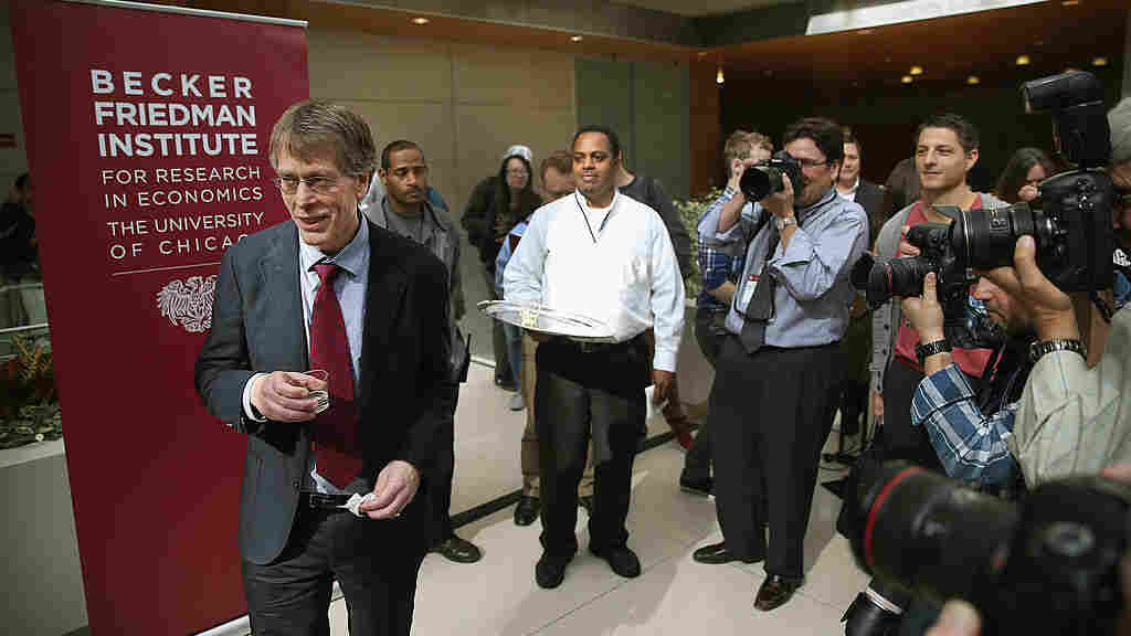CHICAGO, IL - OCTOBER 14: University of Chicago professor Lars Peter Hansen takes a takes a sip of champagne during a toast to celebrate his winning of the Nobel Prize in Economic Sciences on October 14, 2013 in Chicago, Illinois. Hansen, and his U of C colleague Eugene Fama and Yale University professor Robert Shiller will share the prize.
