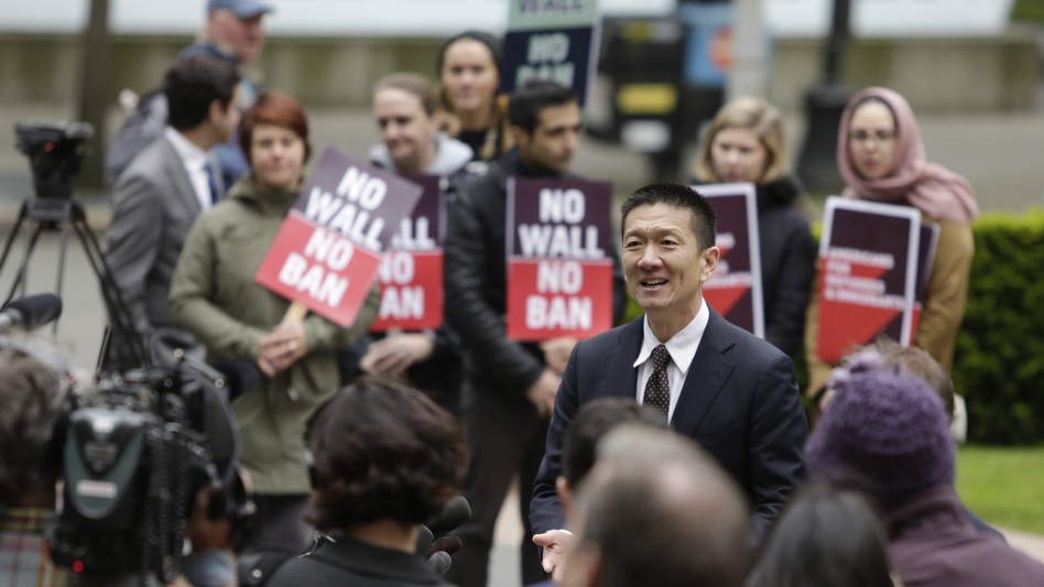Hawaii Attorney General Doug Chin speaks to media outside the 9th Circuit U.S. Court of Appeals in Seattle on May 15. The court has largely upheld a preliminary injunction blocking President Trump's travel ban from going into effect. (Jason Redmond/AFP/Getty Images)