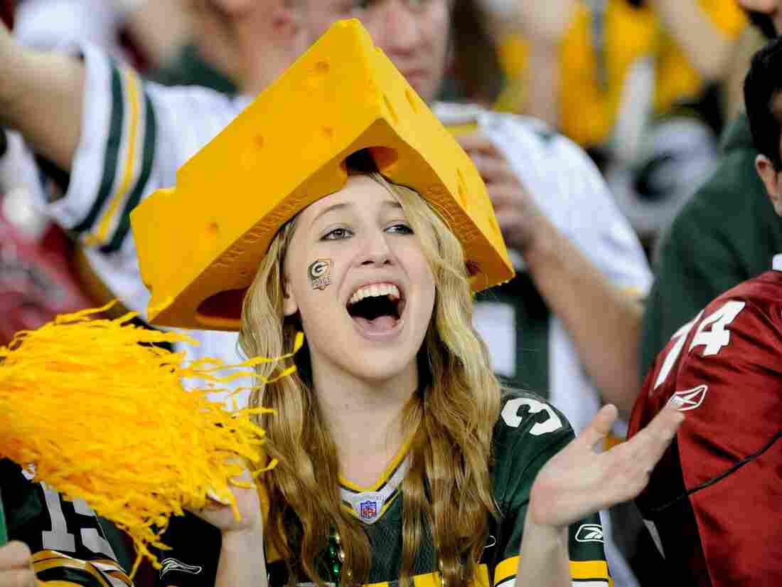 GLENDALE, AZ - JANUARY 10: A fan of the Green Bay Packers with a cheese head cheers against the Arizona Cardinals in the NFC wild-card playoff game at University of Phoenix Stadium on January 10, 2010 in Glendale, Arizona. The Cardinals won the game 51-45 in overtime. (Photo by Rob Tringali/Sportschrome/Getty Images)