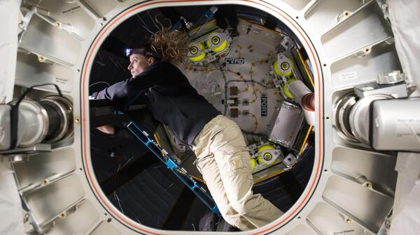 Flight engineer Kate Rubins checks out the Bigelow Expandable Activity Module, which is attached to the International Space Station.