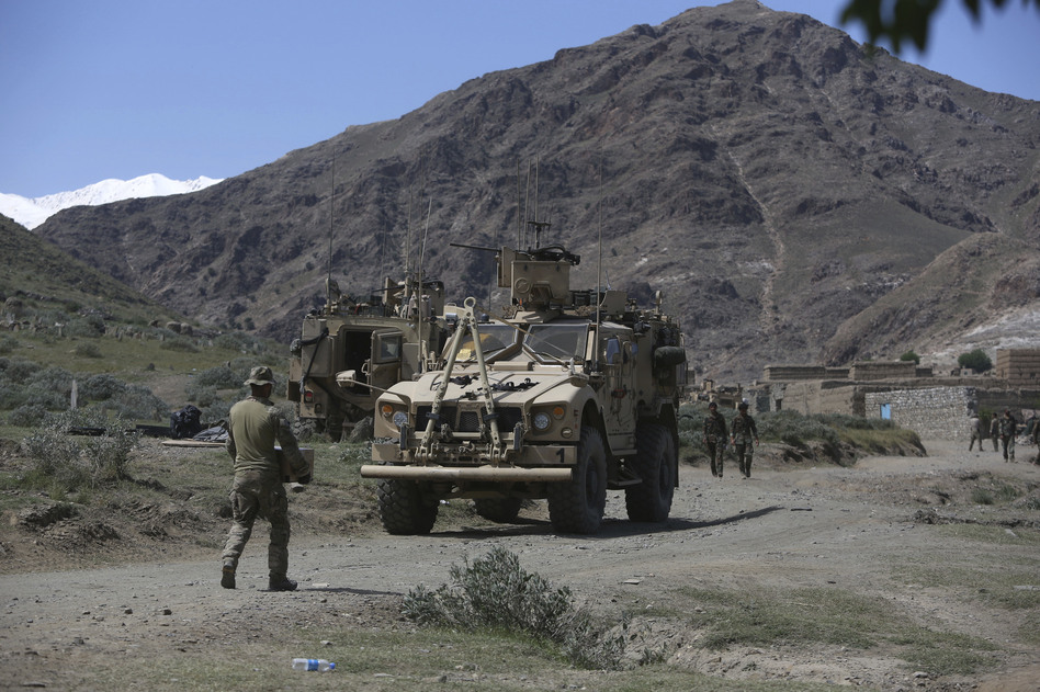 U.S. forces and Afghan commandos in April in Asad Khil village, east of Kabul, Afghanistan. (Rahmat Gul/AP)