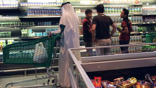 Customers shop at the al-Meera market in Doha on Saturday. Qatar faces possible food and dairy shortages after its Gulf Arab neighbors cut ties with the wealthy nation.