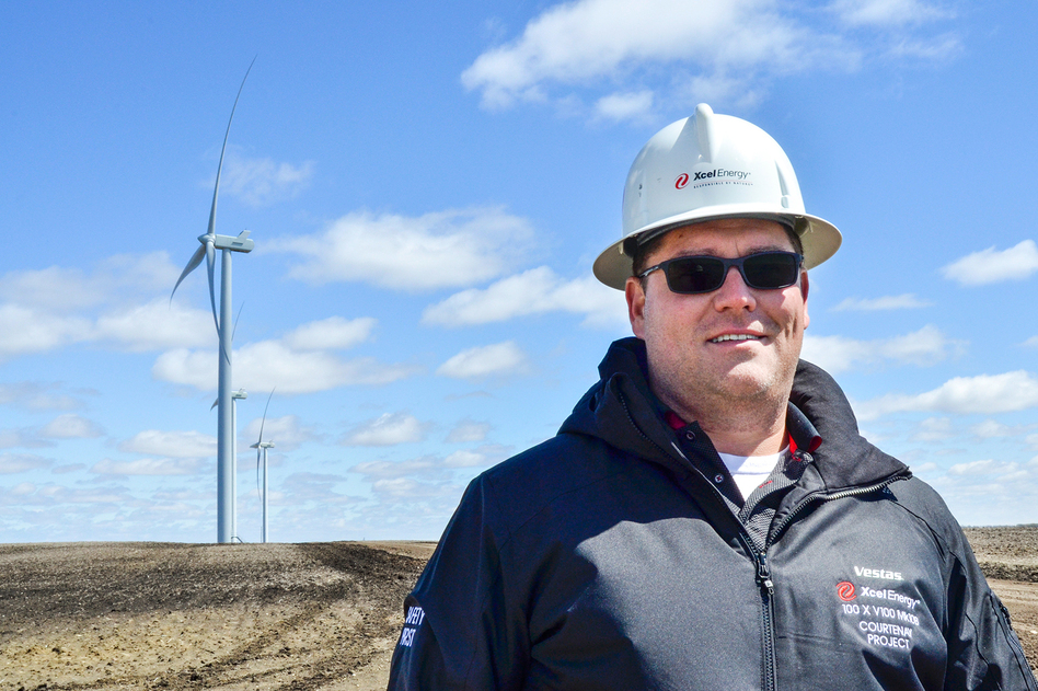 Jayme Orrack oversees Xcel Energy's new wind farm in Courtenay, N.D. The wind farm started generating electricity late last year with 100 turbines that collectively generate 200 megawatts of electricity. (Amy Sisk/Prairie Public Broadcasting)